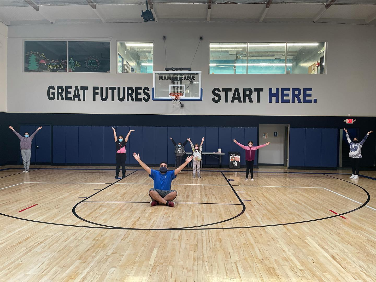 Kids in gym with staff.